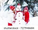 children build snowman. kids...   Shutterstock . vector #727948684