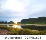 evening sun shines through... | Shutterstock . vector #727981675