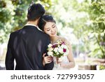 portrait of young asian bride... | Shutterstock . vector #727993057