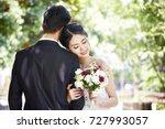 portrait of young asian bride... | Shutterstock . vector #727993057