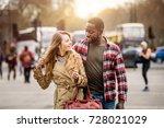multiracial couple walking in