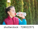 beautiful girl is drinking... | Shutterstock . vector #728022571