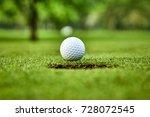 golf ball on the green. golf... | Shutterstock . vector #728072545
