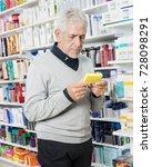 senior customer holding box in... | Shutterstock . vector #728098291