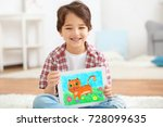 little boy showing his drawing... | Shutterstock . vector #728099635