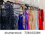 a lot of shiny evening gowns... | Shutterstock . vector #728102284
