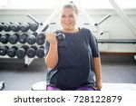 fat girl in a gym | Shutterstock . vector #728122879
