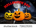 halloween pumpkins on wood in a ... | Shutterstock . vector #728125201