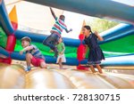 friends jumping on bouncy... | Shutterstock . vector #728130715