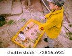 Little Farm Boy Feeding The...