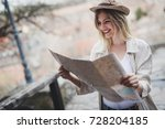 happy female tourist... | Shutterstock . vector #728204185