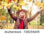 young woman in a hat throws... | Shutterstock . vector #728254645
