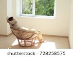 young man resting in armchair
