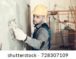 workman in the helmet is... | Shutterstock . vector #728307109