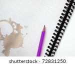 Purple pencil on white note book and Coffee stains - stock photo