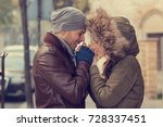 Small photo of Couple in love holding hands.