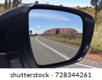 Small photo of Ayers Rock, January 2017 - Driving in Australia: reflection of Uluru in the rear-view mirror. Uluru / Ayers Rock, Northern Territory, Australia