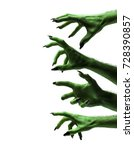 Small photo of Halloween green witches or zombie monster hands