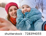 a young mother makes selfie and ... | Shutterstock . vector #728394055