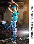 Young woman dancing on industrial background. - stock photo