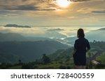 woman standing with her hand in ... | Shutterstock . vector #728400559