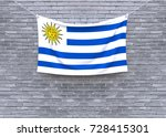 uruguay flag hanging on brick... | Shutterstock . vector #728415301