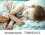 cute boy is sleeping at home. | Shutterstock . vector #728431411