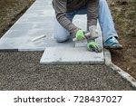 worker hammering the stone... | Shutterstock . vector #728437027