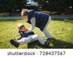 boys fighting in the park | Shutterstock . vector #728437567