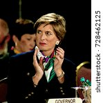 Small photo of Washington, DC. USA, 4th February, 1997 New Jersey Governor Christine Todd Whitman applauds as actor Rob Reiner addresses the annual Governors winter meeting.
