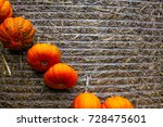 Small photo of Pumpkin Orange Attached Haybale Closeup Background Texture Decoration Autumn Fall Diagonal Pattern