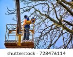 tree pruning and sawing by a... | Shutterstock . vector #728476114