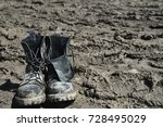 leather dirty shoes in the mud | Shutterstock . vector #728495029
