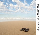 Beach Sandals Or Tongs On A...