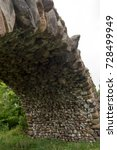 Small photo of TORZHOK, RUSSIA - AUGUST 26, 2017: Arch big boulder arched bridge.