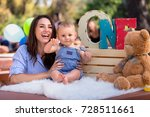 mother and son celebrate 1st... | Shutterstock . vector #728511661