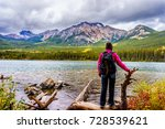 woman hiker at the edge of... | Shutterstock . vector #728539621