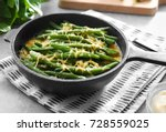 frying pan with delicious green ... | Shutterstock . vector #728559025