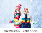 kids playing in snow. | Shutterstock . vector #728577091