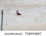 girl playing at the beach in... | Shutterstock . vector #728594887