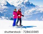 happy mature couple skiing in... | Shutterstock . vector #728610385
