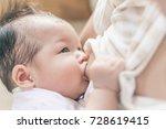breastfeeding at home. | Shutterstock . vector #728619415