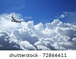 Jet aircraft in a cloudy sky - stock photo