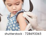 Small photo of Doctor injecting vaccination in arm of asian little child girl,healthy and medical concept