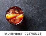 negroni cocktail on dark stone... | Shutterstock . vector #728700115