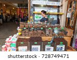 Small photo of The woman behind the counter is a seller of cereal and ground coffee in the market in Batumi.Adzharia, Batumi, September 2017
