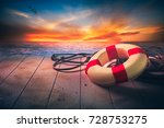 life saver on a dock at the... | Shutterstock . vector #728753275