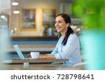 woman using laptop in cafe  | Shutterstock . vector #728798641