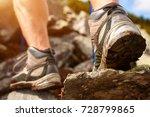 hiking man with trekking boots... | Shutterstock . vector #728799865