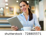 woman using digital tablet in... | Shutterstock . vector #728805571